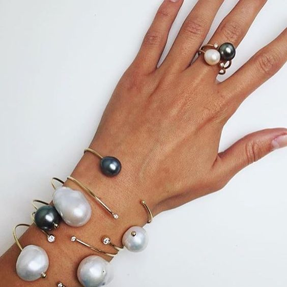 an arrangement of bracelets with classic and baroque perals and rhinestones and a matching ring