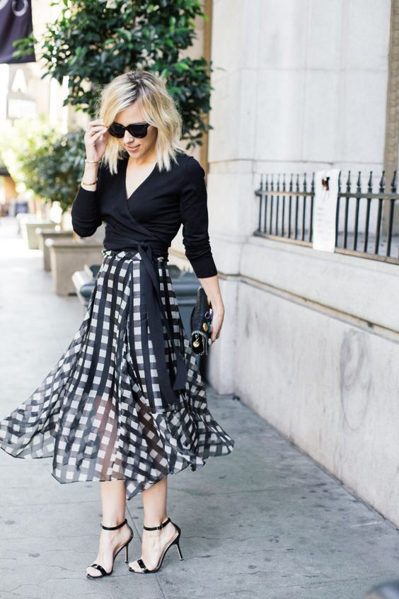 an elegant look with a black wrap crop top, a black and white check midi skirt, black heels and a clutch