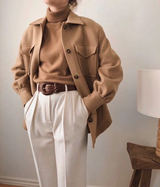 an elegant look with a camel turtleneck, a matching shirt style jacket, white pants, a brown belt