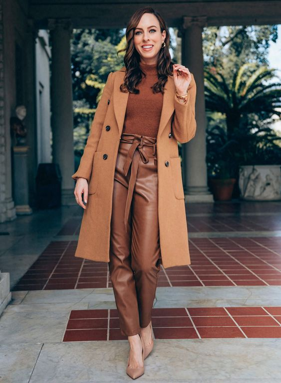 an elegant monochromatic look with a brown turtleneck and camel leather trousers, nude shoes, a camel coat