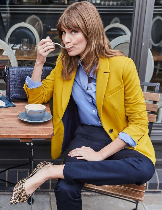 an office outfit with a blue shirt, navy pants, a lemon yellow blazer and leopard shoes