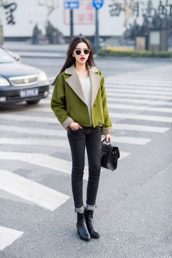 black skinnies, black boots and a bag, a white jumper and a neon green cropped coat for a statement