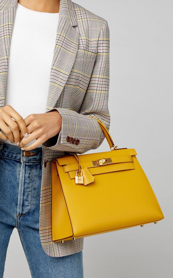 blue jeans, a white t-shirt, a grey plaid blazer and a honey yellow bag for a chic casual look