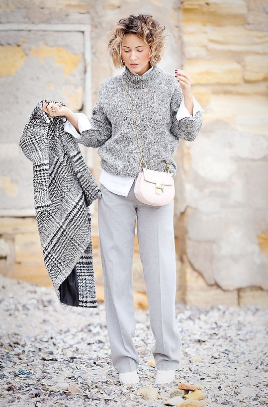 dove grey trousers, a white shirt, a grey sweater, white boots, a blush bag and a grey plaid coat