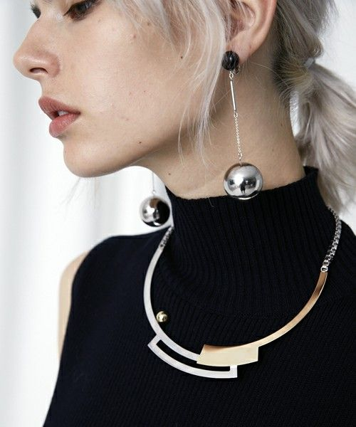 gorgeous silver and black spheric earrings will make your look a statement one immediately