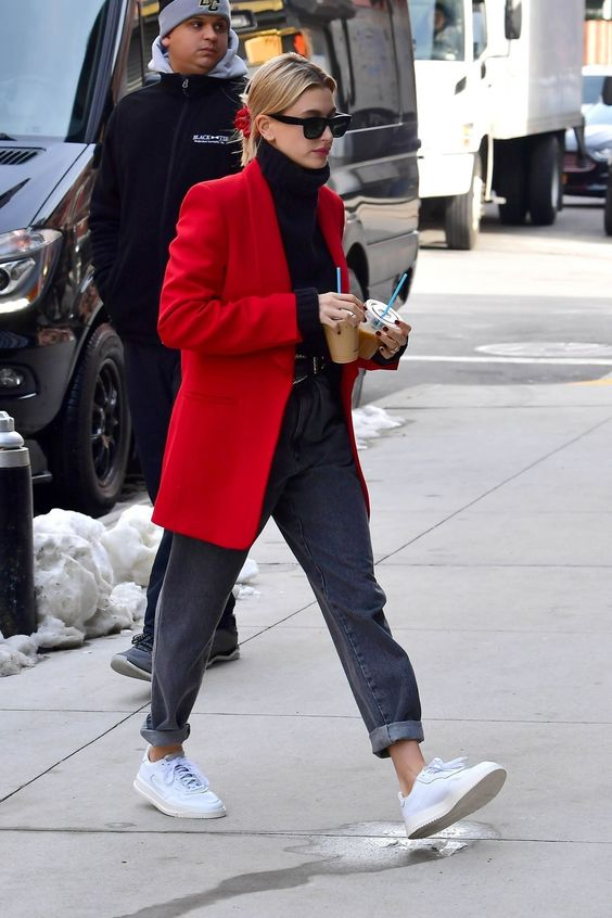 grey jeans, white sneakers, a black turtleneck and a red oversized blazer for a simple and casual look