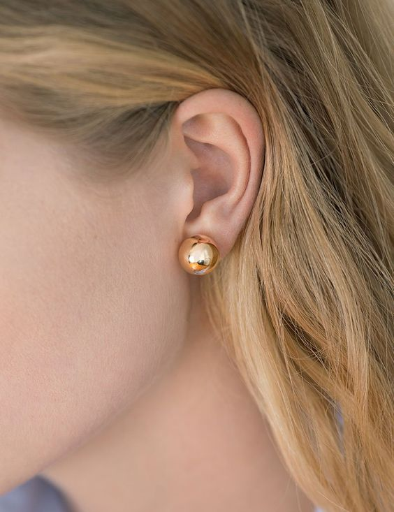 statement gold sphere earrings are a very actual and chic idea to rock, they look amazing