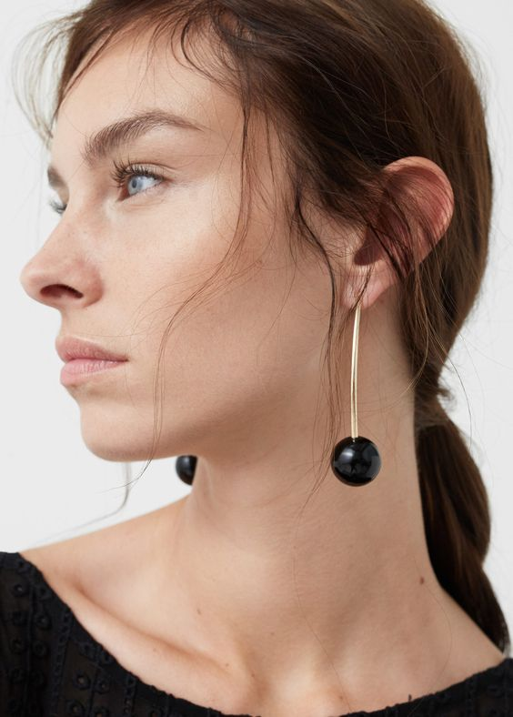 statement spheric drop earrings in gold and black will be a gorgeous addition to your ulra-modern look