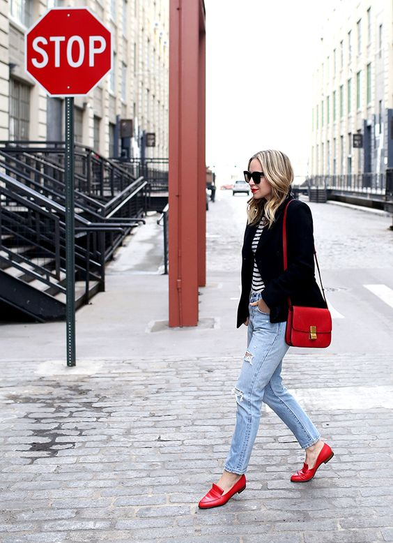 a Parisian look with a striped top, a black blazer, blue ripped jeans, red loafers and a red bag