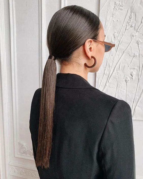 forget twists, textures and bumps and go for a simple and sleek ponytail to look in trend