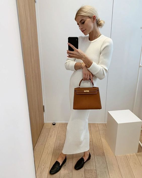 a white knit maxi dress with long sleeves, black loafers and a cognac-colored bag for a feminine feel