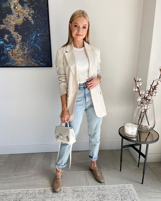 a white t-shirt, light blue jeans, grey loafers, a creamy blazer, a neutral mini bag for spring