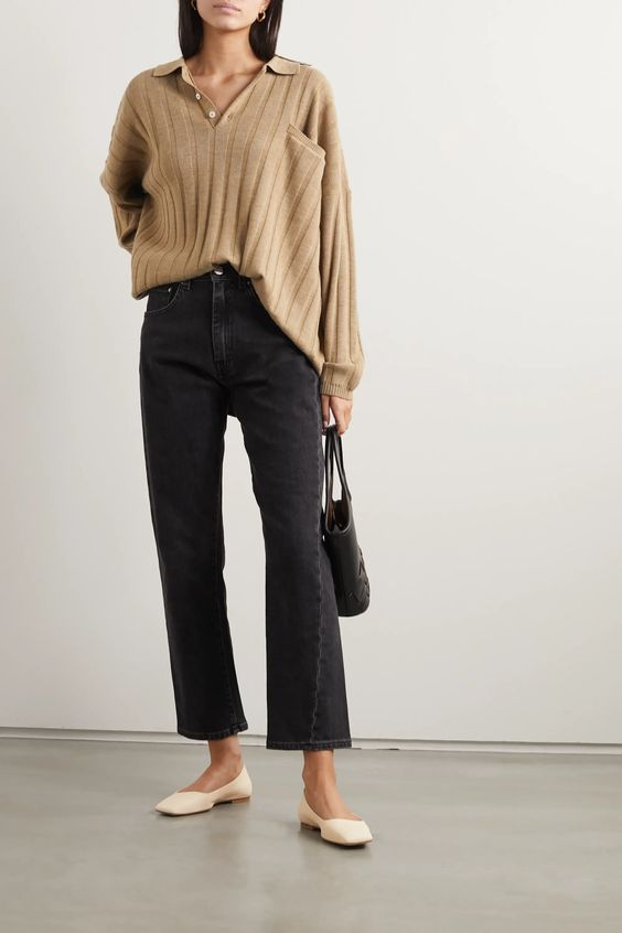 black flare jeans, a tan oversized polo shirt with a pocket and white square toe flats plus a black bag