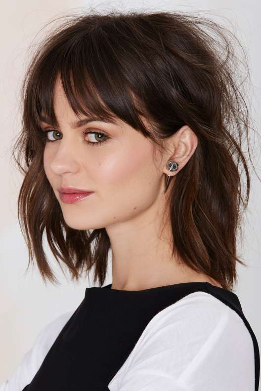 a messy and textural medium bob with a fringe is a cool idea inspired by the 70s