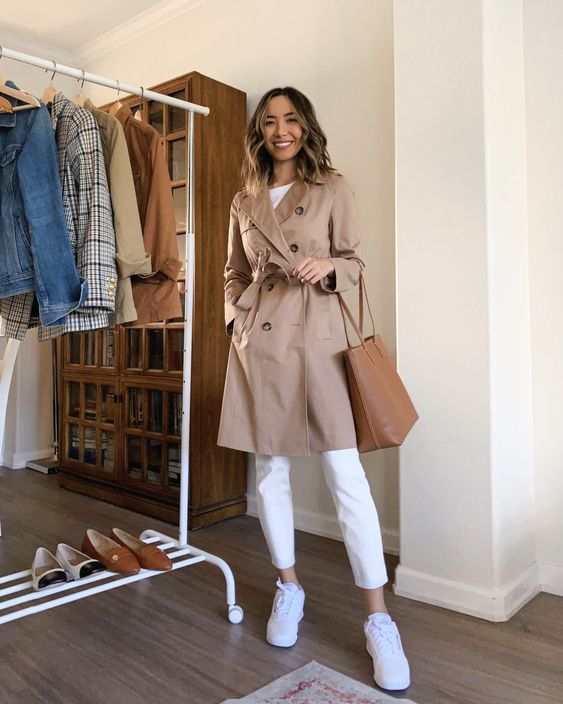 an actual look with a white tee, white jeans, white trainers, a camel trench and a brown bag