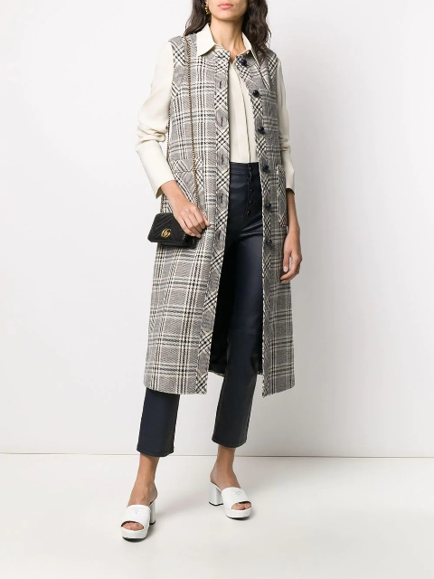 With beige button down shirt, chain strap bag, crop trousers and white platform sandals
