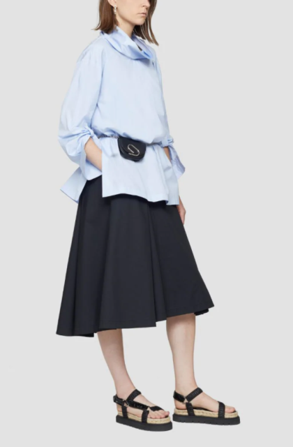 With black A-line skirt, waist bag and platform sandals