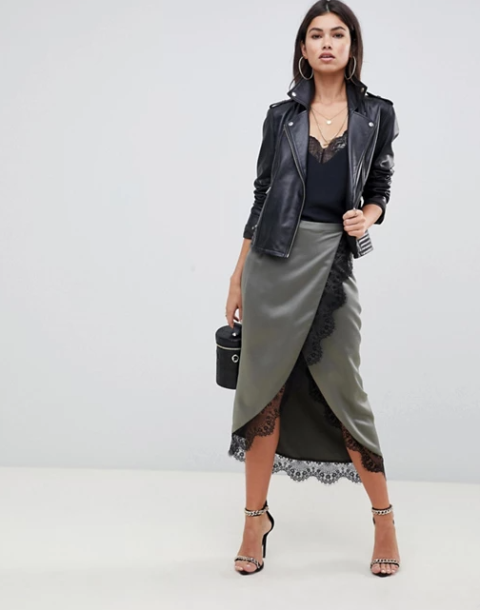 With black lace top, black leather jacket, black bag and embellished shoes