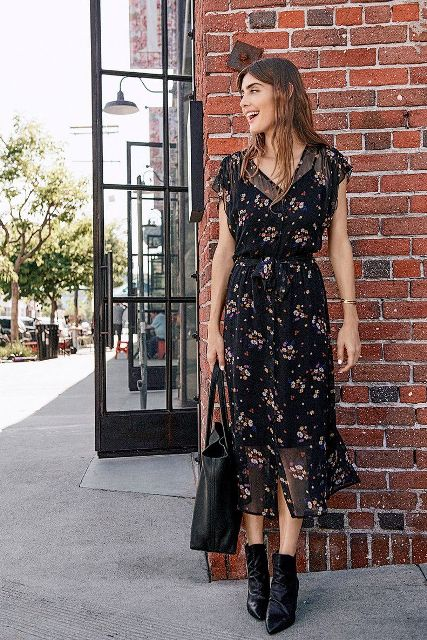 With black leather tote bag and black ankle boots