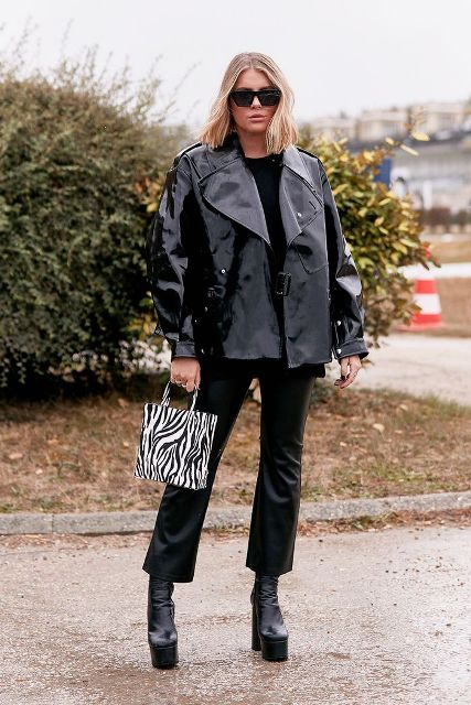 With black shirt, black leather cropped trousers, zebra printed bag and leather jacket