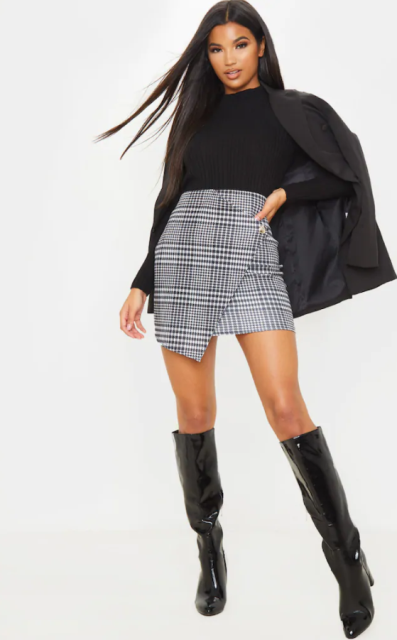 With black sweater, black blazer and black patent leather high boots