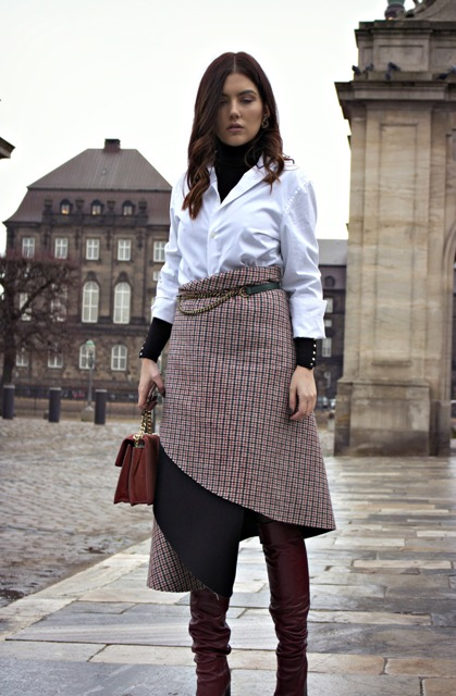 With black turtleneck, white blouse, brown bag and brown over the knee boots