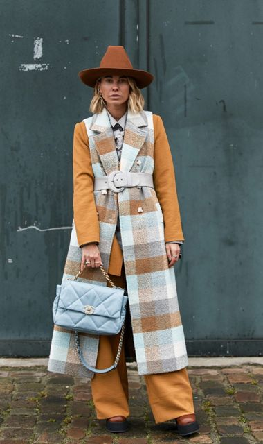 With brown blazer, brown palazzo pants, light blue bag, platform boots and brown hat