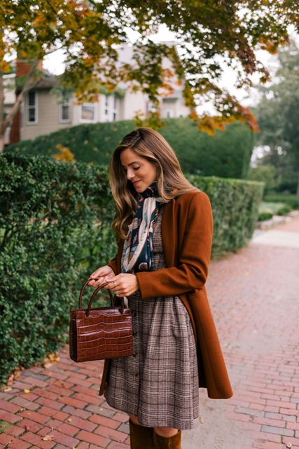 With brown cardigan, brown leather bag, brown suede high boots and printed scarf