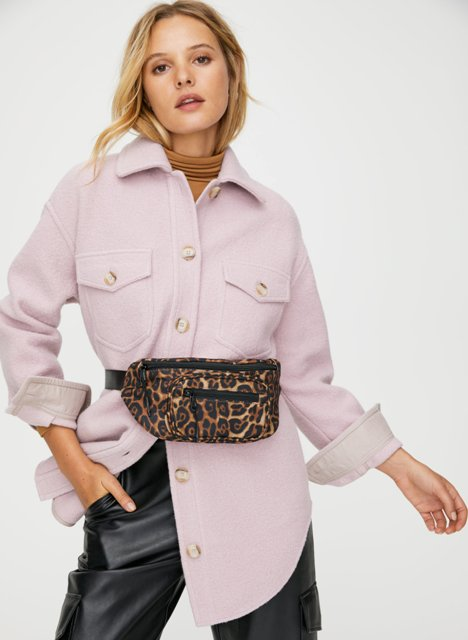 With brown turtleneck, pale pink long jacket and black leather trousers