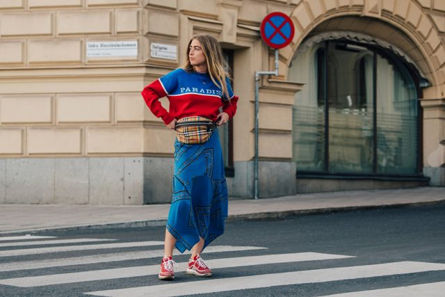 With color block sweater, denim skirt and red sneakers