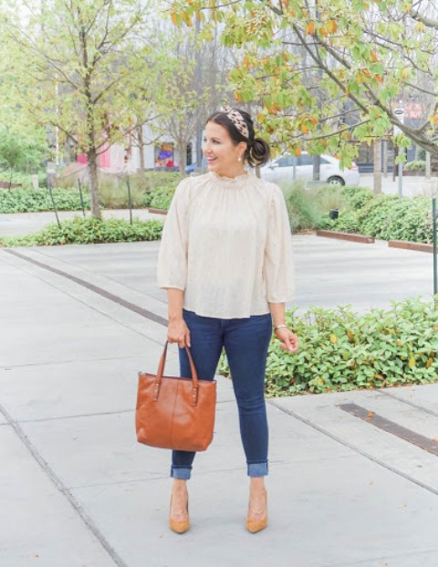 With cuffed jeans, brown leather tote bag and yellow pumps