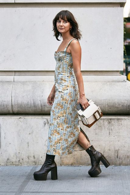 With floral maxi dress and white and brown bag