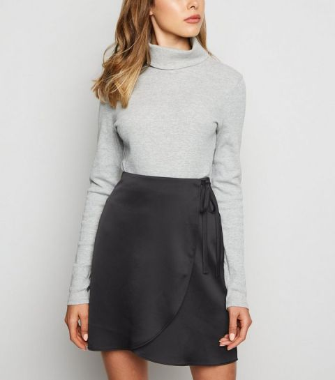 With gray turtleneck