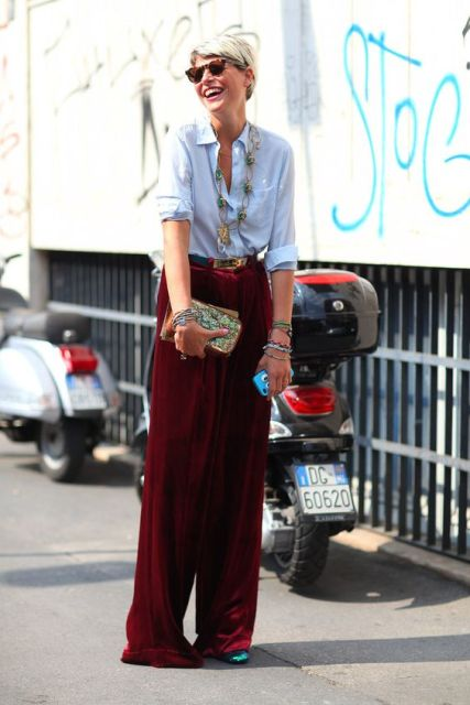 With light blue button down shirt, necklace, sunglasses, green shoes and embellished clutch