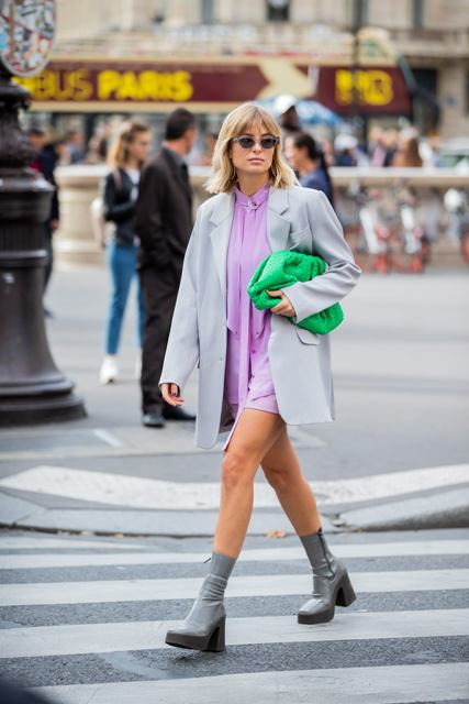 With lilac mini dress, gray loose blazer and green clutch