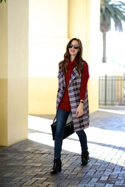With marsala sweater, navy blue jeans, lace up boots and tote bag