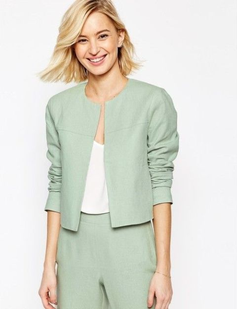 With mint green trousers and white top