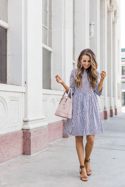 With pale pink bag and brown ankle strap shoes
