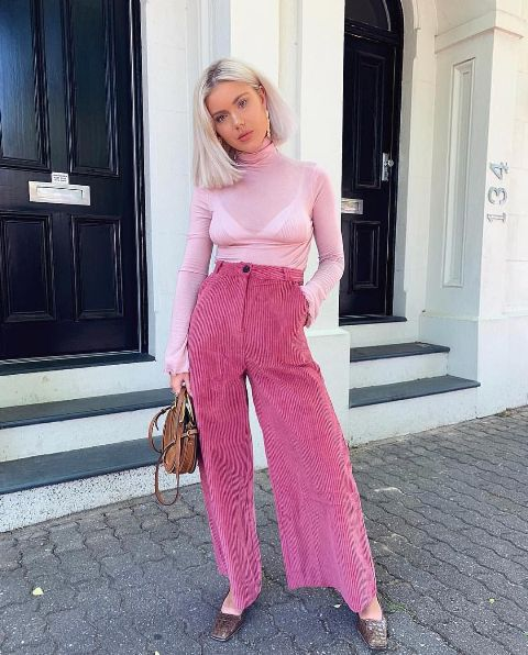 With pale pink turtleneck, brown rounded bag and flat shoes