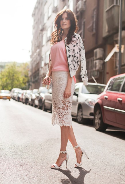With pink top, black and white floral printed bomber jacket and white ankle strap shoes