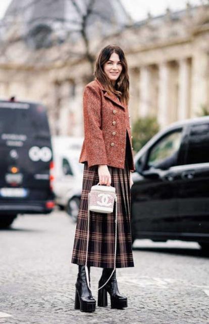 With plaid midi skirt, tweed jacket and bag