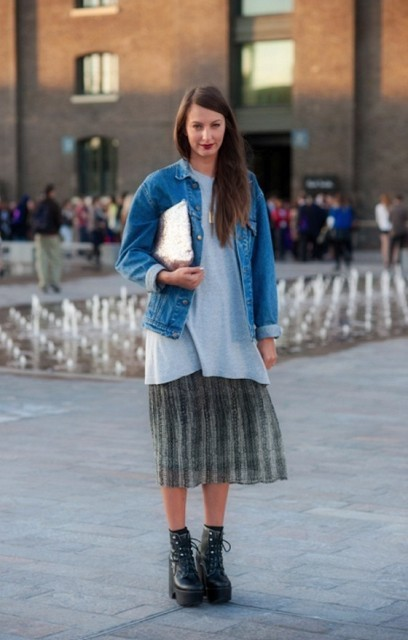 With pleated skirt, denim jacket, silver clutch and gray loose shirt