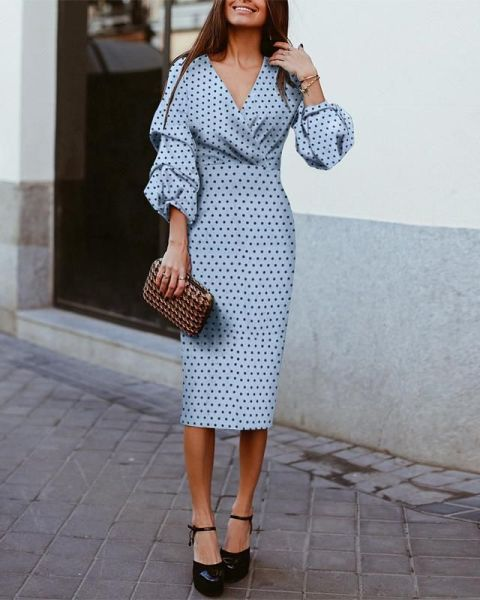 With printed clutch and black platform shoes