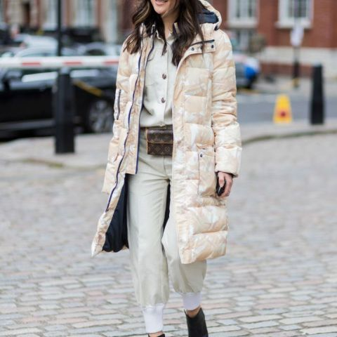 With shirt, white jogger pants, pastel colored puffer coat and black boots