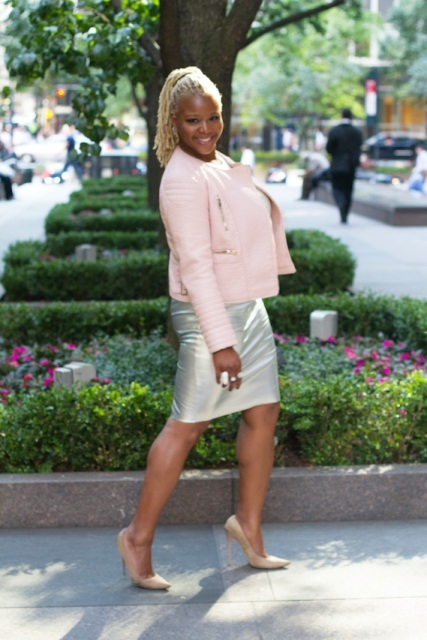 With silver skirt and beige pumps
