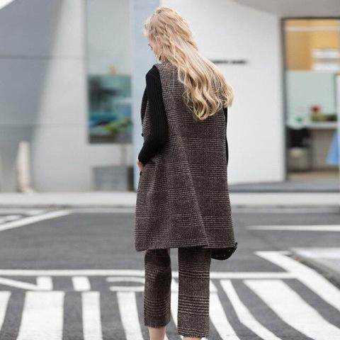 With tweed culottes and black long sleeve shirt