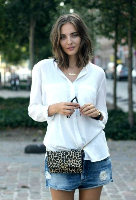 With white button down loose shirt and denim shorts
