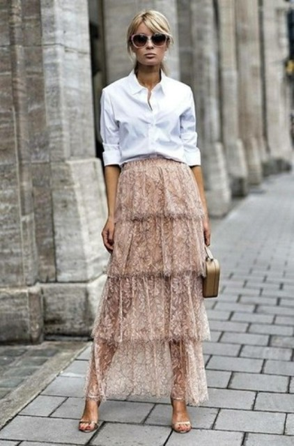 With white button down shirt, beige bag and high heels
