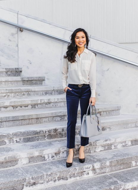 With white button down shirt, gray leather tote bag and black pumps