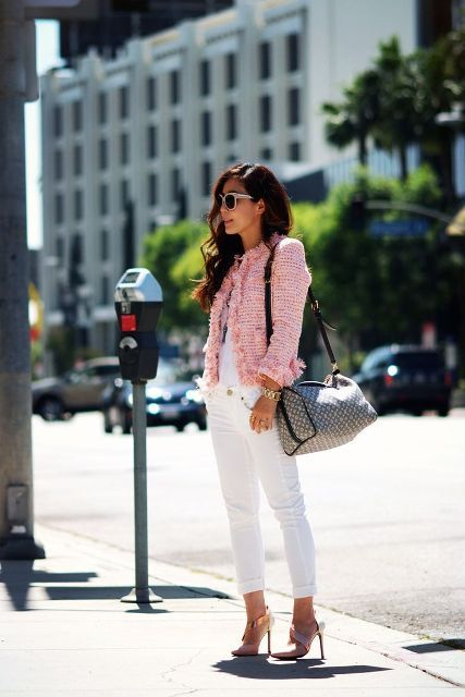 With white cuffed pants, printed bag and high heels